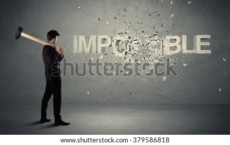 Business man hitting impossible sign with hammer on grungy wall - stock photo