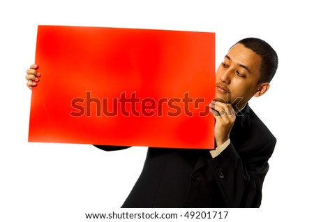 Business man hold a red blank sign isolated on white background. You can write your message on the red sign - stock photo