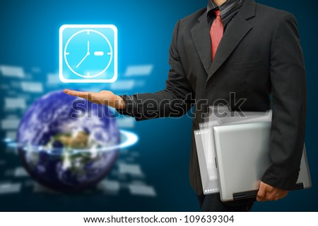 Business man hold Clock icon : Elements of this image furnished by NASA