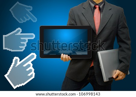 Business man hold digital tablet and the hand point to him