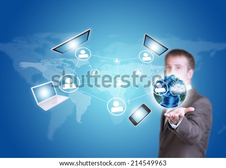 Business man hold Earth globe and electronics