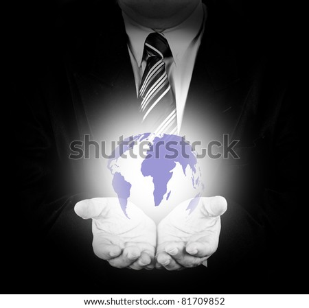 Business man hold glowing earth