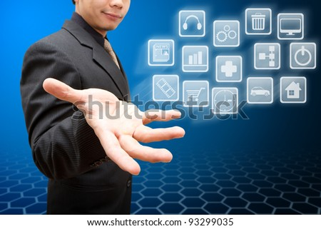 Business man hold many icon - stock photo