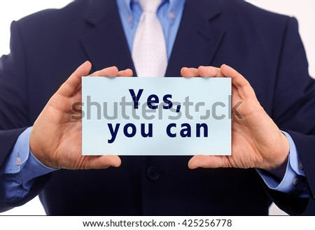 Business man hold paper yes, you can text on it - stock photo