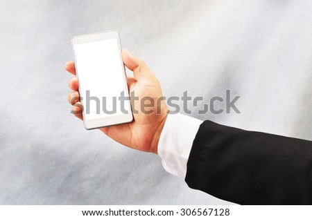 business man hold smart phone - stock photo