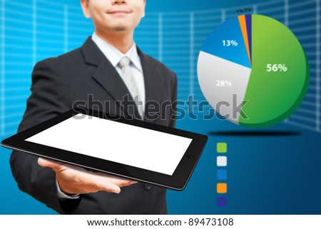 Business man Hold tablet computer and graph background