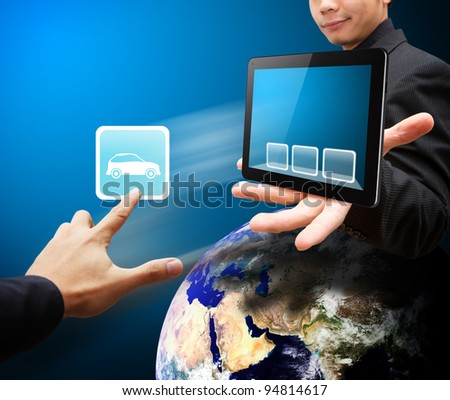 Business man hold tablet PC and touch on car icon - stock photo