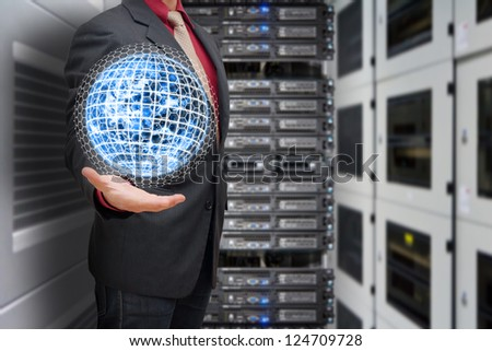 Business man hold the digital earth in data center room : Elements of this image furnished by NASA - stock photo