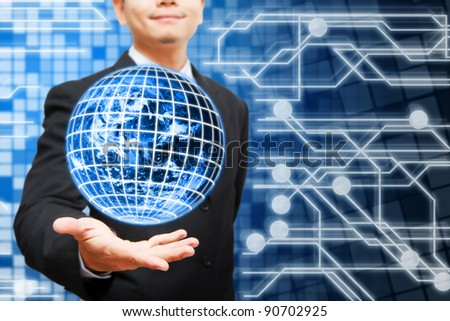 Business man hold The Digital World and digital background