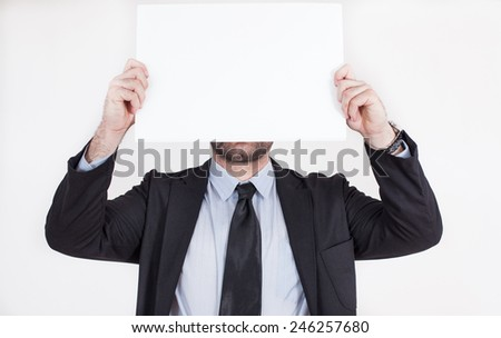 Business man holding a banner for advertising