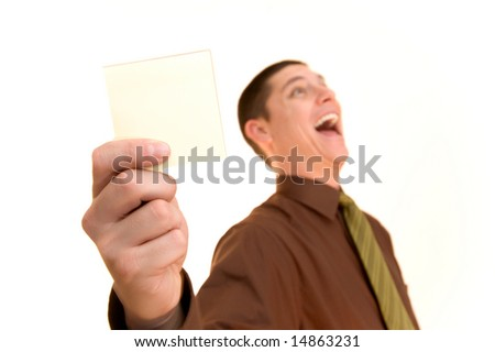 business man holding a blank memo note