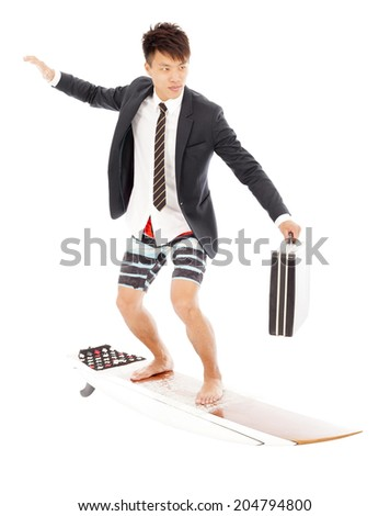 business man holding a briefcase and standing surfing board - stock photo