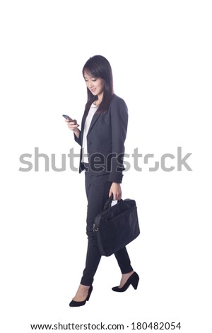 business man holding a briefcase and use phone on white background  - stock photo