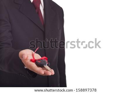 Business man holding a car key. - stock photo