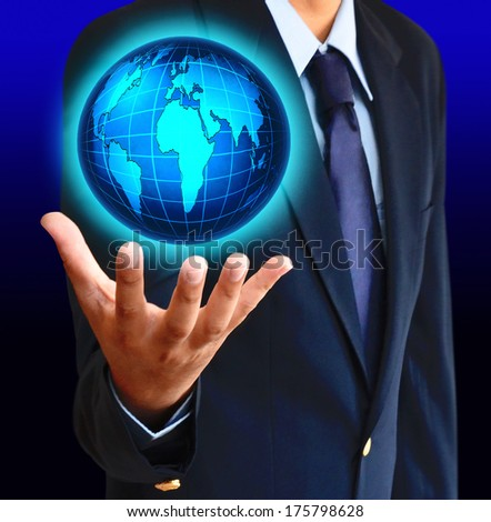 Business man holding a glowing earth globe in his hands
