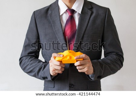 Business man holding a joystick - manipulation, controlling, entertainment concept - stock photo