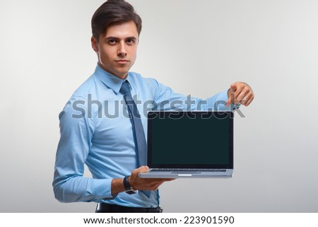 Business man holding a laptop against a white background
