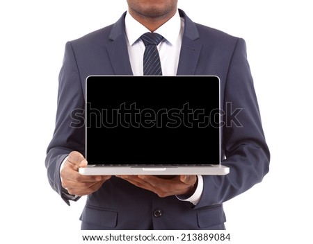 Business man holding a laptop, isolated on white background