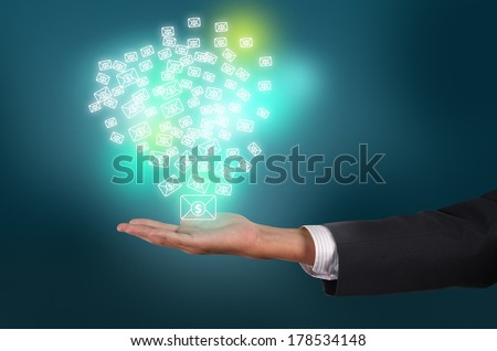 business man holding and receive money message with email on cloud technology concept