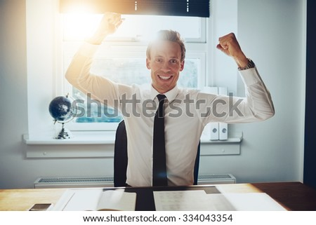 Business man holding arms over head and celebrating success, business success concept - stock photo