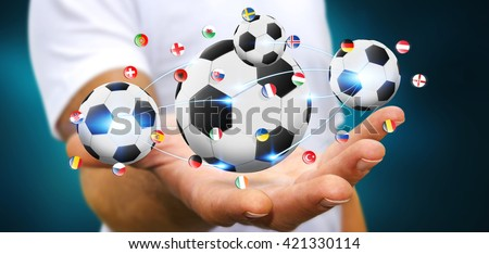 Business man holding back and white foot ball in his hand '3D rendering' - stock photo