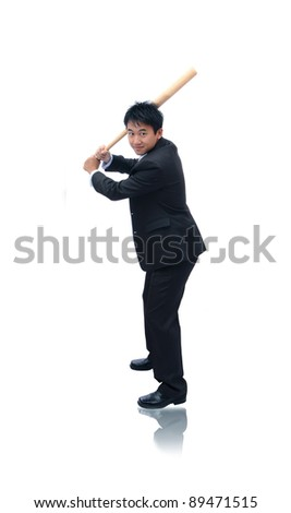 Business man holding baseball bat ready for a hit - stock photo