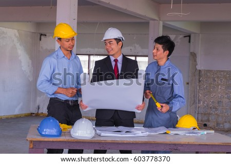 Business man holding blueprint discussing about stock photo royalty business man holding blueprint discussing about building plan for construction at job site with engineer and malvernweather Image collections