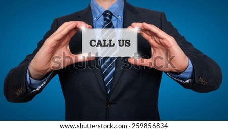 Business man holding Call Us card. Blue - Stock Photo - stock photo