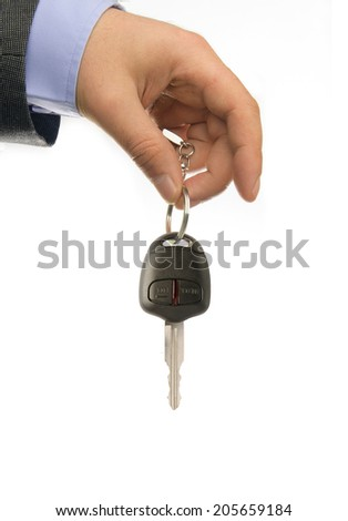 business man holding car key, close-up - stock photo