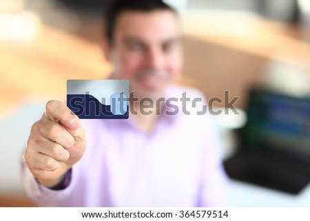 Business man holding credit card