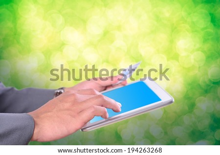Business man holding credit card and press key for shopping online / buy / e-commerce - stock photo