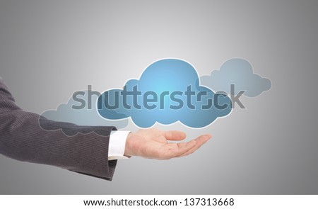 business man holding digital cloud with copy space - stock photo