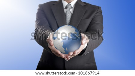 Business man holding digital globe with two hands
