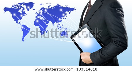 Business man holding digital tablet PC to connect with the world - stock photo
