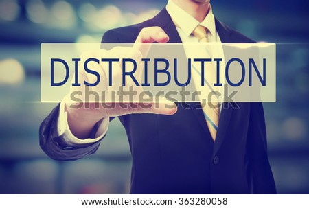 Business man holding Distribution on blurred abstract background   - stock photo