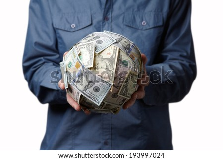 Business man holding dollars globe - stock photo