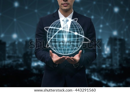 business man holding global connection icon,business global concept,business technology concept - stock photo