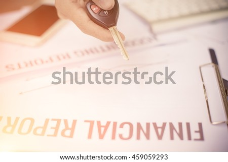 "Business man holding ""KEY"" button stock chart and Keyboard"