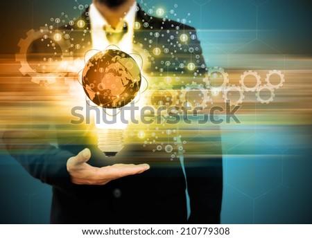 business man holding light bulb Social Network - stock photo