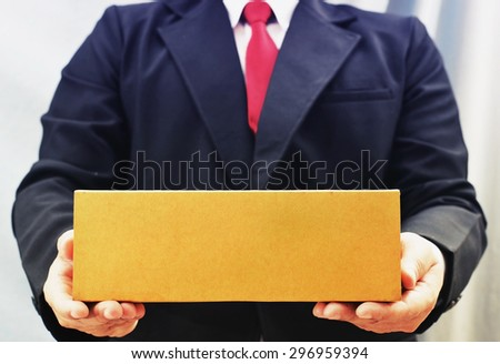 business man holding long box  - stock photo