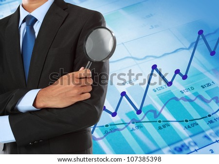 business man holding magnifying glass concept - stock photo