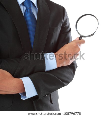business man holding magnifying glass isolated on white background - stock photo