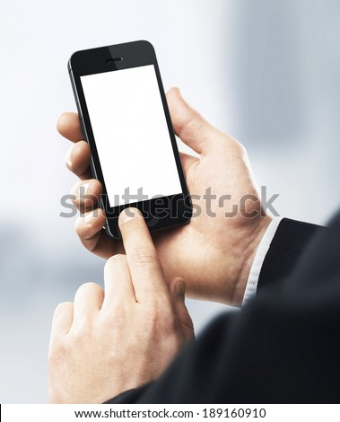 Business man holding phone - stock photo