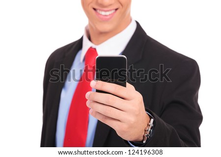 Business man holding smartphone - close up picture