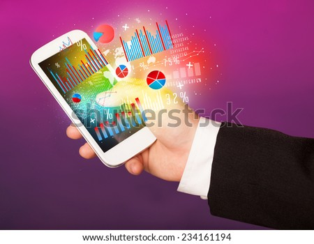 Business man holding smartphone with chart symbols concept - stock photo