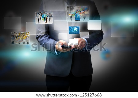 Business man holding social media - stock photo