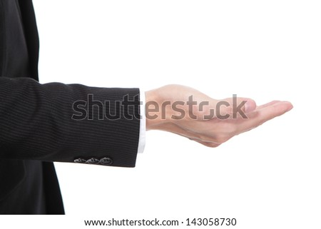 Business man holding something on his hand close up isolated on white background, copy space area in the image is great for you