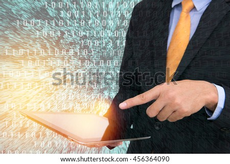 business man holding tablet and using touchpad with technology background. - stock photo
