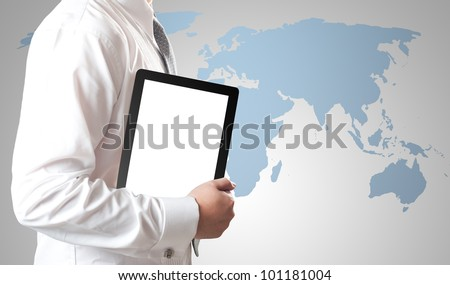 Business man holding tablet PC with world map in background - stock photo