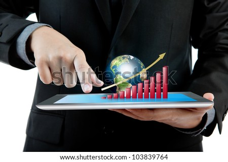Business man holding the modern digital tablet pc with success growth chart and earth (Elements of this image furnished by NASA) - stock photo